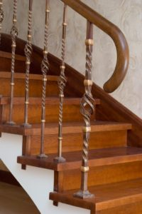 traditional-wrought-iron-balustrade-with-wooden-handrail